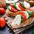 bruschetta · tomates · mozzarella · albahaca · tomates · cherry - foto stock © vankad