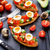 bruschetta with tomato avocado and quail egg stock photo © vankad