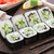 sushi rolls with cucumber and sesame seed stock photo © vankad