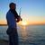 fisherman fishes at the sunset stock photo © vapi