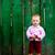 Baby near green fence stock photo © velkol
