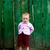 Baby-girl near green fence stock photo © velkol