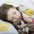 little girl sleeping in bed with teddy bear stock photo © velkol