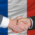 businessmen handshake after good deal in front of france flag stock photo © vepar5