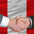 businessmen handshake after good deal in front of peru flag stock photo © vepar5