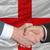 businessmen handshake after good deal in front of england flag stock photo © vepar5