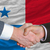 businessmen handshake after good deal in front of panama flag stock photo © vepar5