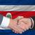 businessmen handshakeafter good deal in front of costarica flag stock photo © vepar5
