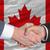 businessmen handshake after good deal in front of canada flag stock photo © vepar5
