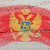 flag of montenegro on grunge wooden texture painted with chalk   stock photo © vepar5