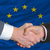 businessmen handshake after good deal in front of europe flag stock photo © vepar5