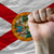 us state flag of florida with hard fist in front of it symbolizi stock photo © vepar5