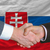 businessmen handshake after good deal in front of slovakia flag stock photo © vepar5