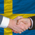 businessmen handshake after good deal in front of sweden flag stock photo © vepar5