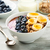 tazón · cereales · bayas · frutas · maíz · energía - foto stock © vertmedia