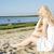Woman in white dress indulgence on beach stock photo © vetdoctor
