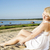 Woman in white dress indulgence on sand stock photo © vetdoctor
