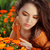 young woman outdoors portrait over orange marigold flowers stock photo © victoria_andreas