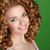 curly hair attractive smiling woman portrait on green backgroun stock photo © victoria_andreas