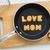 letter cookies word love mom and kitchen utensils stock photo © vinnstock