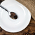 coffee beans on spoon with white plate and surrounding coffeebea stock photo © viperfzk
