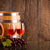 two glasses of ros wine with two barrels and grapes stock photo © viperfzk