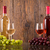 glasses of wine with bottles and grapes stock photo © viperfzk