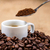 white coffeecup on coffeebeans with spoon above stock photo © viperfzk