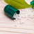 Open capsule with small white specs and green leaf stock photo © viperfzk