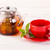 teapot and red cup on wooden table stock photo © viperfzk