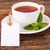 Cup of tea with green leaves and white tag stock photo © viperfzk