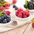 fresh berries in bowls stock photo © vitalina_rybakova