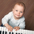 baby play black and white piano stock photo © vkraskouski