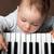 baba · játék · zene · zongora · billentyűzet · portré - stock fotó © vkraskouski