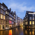 view of famous amsterdam canal by night stock photo © vwalakte