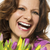 smiling woman with flowers stock photo © w20er