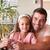 pai · ajuda · filha · lição · de · casa · menina · livro - foto stock © wavebreak_media