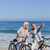 mature couple with their bikes on the beach stock photo © wavebreak_media