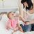 Charming brunette female bottle-feeding her baby on a bed in her appartment stock photo © wavebreak_media