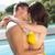 romantic young couple by swimming pool stock photo © wavebreak_media