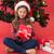 festive little girl holding gift stock photo © wavebreak_media