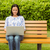 smiling brunette sitting on bench using laptop stock photo © wavebreak_media