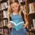 aranyos · kislány · olvas · könyv · könyvtár · portré - stock fotó © wavebreak_media