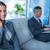 zakenvrouw · telefoongesprek · collega · met · behulp · van · laptop · kantoor · computer - stockfoto © wavebreak_media