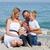 mutlu · çocuklar · ebeveyn · oturma · kum · plaj - stok fotoğraf © wavebreak_media