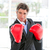 self assured businessman wearing boxing gloves stock photo © wavebreak_media