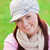 Happy young woman wearing cap and scarf smiling at the camera stock photo © wavebreak_media
