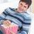 encantado · moço · alimentação · pipoca · sofá · casa - foto stock © wavebreak_media