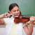 schoolgirl playing the violin in a classroom stock photo © wavebreak_media