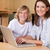 Mother and son with laptop in the kitchen stock photo © wavebreak_media